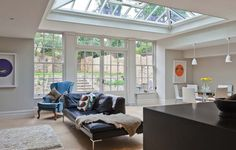 This kitchen extension has Georgian sash windows and an inset glazed roof. A lovely orangery.