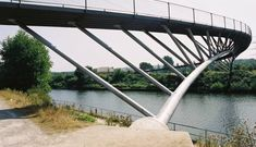 The Ripshorst footbridge in Oberhausen, Germany, is one example of how to deal with a curved deck for a mostly straight arch.