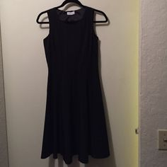 ✂️REDUCED FROM $45 to $35✂️ Figure flattering black dress.  Good for work or can be dressed up! 95% polyester 5% spandex.  Dry clean only.  Completely lined with  a side zipper. Calvin Klein Dresses Midi