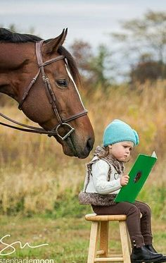 Yep, cute little Esa, reading to her horse bc it needs attention.