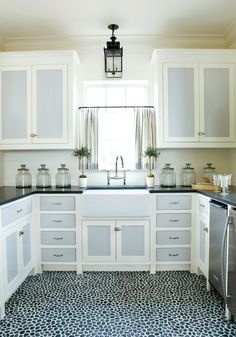 Pebble mosaic tile floor in pool house kitchen. Two toned cornflower blue and white cabinets. http://cococozy.com