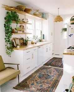 boho kitchen decor Persian Moroccan rug greenery plants