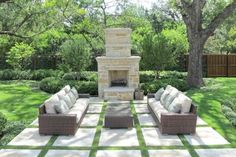 This patio is constructed from a number of square stone slabs lined with patches of grass. The grass then merges with the surrounding space. This is a lovely use of grass that demonstrates just how well it can accentuate other features.