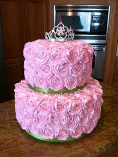 Princess cake. (Michelle, I have done a similar cake and it turned out pretty cute). Could do ombre effect with the flowers and use colors from disney princesses and top with cinderella shoe, disney princess figures or crown.