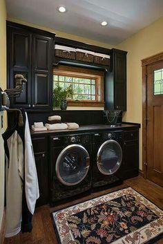 Dream laundry room! Love the black appliances with the black cabinetry!!!