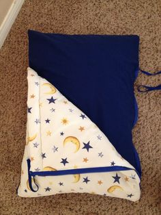 """Baby Sleeping Bag for on the go. Easy to make with 2 standard pillowcases. Shorten, quilt batting added for fluffiness, moon pillowcase sewn to left side of blue pillowcase, next add side zipper and 15"""" ties to right side of blue pillowcase. LAST ADD final bottom zipper. Zipper lengths will vary depending on pillowcase size."""