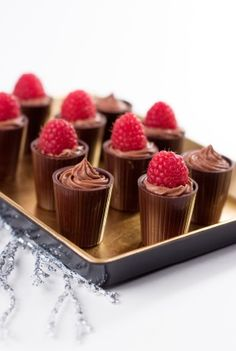 Chocolate Shooters ~ Dark chocolate cups, filled with homemade chocolate mousse and topped with a raspberry. Check Cost Plus ? For chocolate dessert cups. Mini Desserts, Just Desserts, Delicious Desserts, Dessert Recipes, Yummy Food, Dessert Cups, Raspberry Desserts, Chocolate Cups, Homemade Chocolate