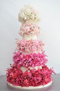 Sylvia Weinstock takes the ombré trend to a whole new level with this fabulous white wedding cake packed with pink sugar flowers. #weddingcake #dessert #ombreweddingcake