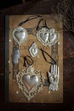 Ex Voto Pendants from Mothology ~ The Science of Style Milagros Charms, Tin Art, Heart Of Jesus, Mexican Folk Art, Sacred Heart, Heart Art, Religious Art, Belle Photo, Altered Art