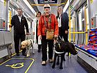 Minister for Public Transport Jacinta Allan and representatives of Guide Dogs Victoria inspect the High Capacity Metro Train mock-up.
