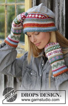 Knitted hat in DROPS Karisma. The piece is worked with folded edge and Nordic pattern. Knitted mittens in DROPS Karisma. The piece is worked with a folded edge and Nordic pattern. Knitted Slippers, Knit Mittens, Knitted Hats, Fair Isle Knitting Patterns, Christmas Knitting Patterns, Tejido Fair Isle, Motif Fair Isle, Striped Mittens, Magazine Drops