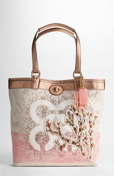 COACH AUDREY CORAL CANVAS LEIGH SLIM TOTE $298 I'm usually not a Coach kinda gal, but this made my heart stop. Seriously, this is adorable. Officially, on my wish list.
