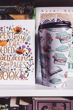 We spend our lives folded between the pages of books—true. Love these bookish designs from EvieSeo on Redbubble. Pair a journal to keep track of your to-read list with a travel mug filled with honey and tea and you're sure to have a wonderful day.
