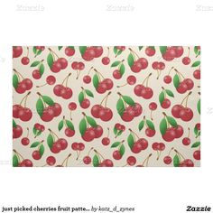 This bright red cherries pattern cotton fabric has single and paired cherry fruit with stems and green leaves attached, as if just picked from the cherry tree, randomly arranged on a customizable ivory background | by katzdzynes