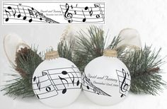musical notes wedding ornament favor. You could print up stickers with your names and date..@Heaven Anne.The could be hung on your tree as favors.
