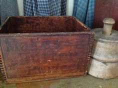 old crate that once held butter coloring & butter mold
