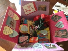 """Anniversary care package! Each item in box has a love saying to go with it. Ie: Swedish fish says """" of all the fish in the sea, I'm glad you picked me!"""" Flowers say """" possibilities bloom with you in my life!"""""""