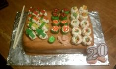Candy Sushi Cake.     I used rice krispie treats and multi-colored Twizzlers to make the California roll, marshmallows and mini M's to make the roe, and Swedish fish for the sashimi. The wasabi and ginger are buttercream icing. And I made the cake look like wood by covering it in rolled marzipan and then painting it with brown food coloring gel.