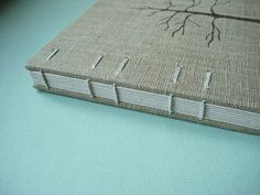 This is coptic binding with reindeer leather spine. Covers are brown tarred paper with white leaves painted in acrylics. 96 sturdy white pages sewn with waxed linen thread. Tree Stencil, Stencils, Small Book, White Leaf, Tree Print, Pen And Paper, Book Binding, Book Making, Fabric Covered