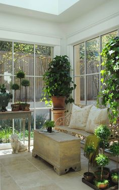 Garden inside - lovely bench/pillows! Nice balance creating a cozy corner...