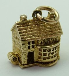 1960s English 9ct gold Nuvo charm of 'Ye Olde Sweet Shoppe' that opens to reveal a child inside buying sweets - hallmarked for Birmingham 1960 and marked 'Nuvo Regd'