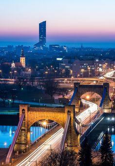 https://flic.kr/p/qfrKhZ | Landmarks | Two landmarks of Wroclaw (Poland) - Grunwaldzki Bridge, old suspension bridge built in 1910, and Sky Tower, the highest building in Poland (212m/695ft). http://www.facebook.com/MLFotArch