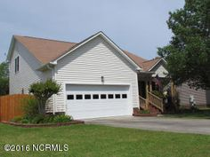 NEW LISTING!!  561 Huff Drive  Winterville, NC 28590- Priced @ $155,000.00: Adorable home on quiet street. 3 bedrooms and a loft office. master on the first floor. amazing yard, private and so well landscaped. Large greenroom and kitchen. double car garage, wooded lot and covered front porch. a must see. A few surprise closets that are much larger than you'd expect.