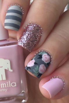 Here we see what I mention in previous image. Grey color is combined with pink roses and green details. One nail is in very light pink shade. There's also a little bit of black color, and beautifully golden sparkle on middle finger. http://www.koogal.com.au/