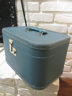 Vintage Blue Traincase  1950s Luggage by MemphisNanney on Etsy, $24.00 - My grandmother had one of these. I used to love to dig through it, and loved the way it smelled.