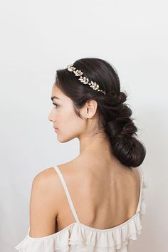 Learn how to create this easy yet elegant layered twisted chignon finished off with a delicately dazzling headpiece from BHLDN. | Photo by Christina McNeill | Hair tutorial by Mimi & Taylor