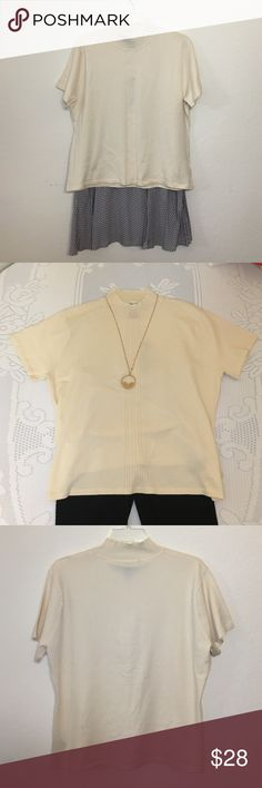 Vintage Cream High Neck Short Sleeve Sweater Cream short sleeve sweater with high neck/mock turtle neck. Silk/nylon/cotton blend so incredible soft and gorgeous. Very 90s, I could see this on Rachel from Friends. New with tags, brand is Jones Wear (I believe affiliated with Jones New York). I'm open to offers! (Necklace and skirt not for sale, leggings available in another listing) Vintage Sweaters Cowl & Turtlenecks