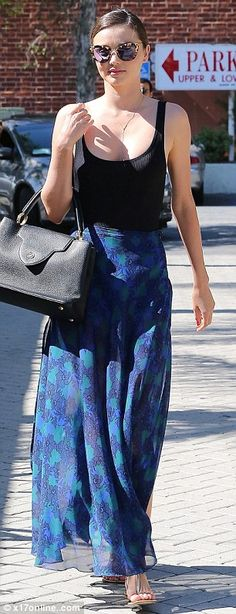 Work it! To accessorise, Miranda slipped her red pedicured feet into simple T-strap sandal...