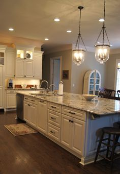 Refinished cabinets in a beautiful creamy white-with a soft grey glaze and grey walls