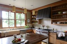 Wall relief tiles by Pratt  Larson look super chic in this Portland kitchen by Emerick Architects.