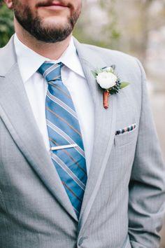 Dapper gray suit: http://www.stylemepretty.com/north-carolina-weddings/wilmington-nc/2015/06/12/courtyards-cobbletones-rustic-copper-engagement-wedding-inspiration/   Photography: Millie Holloman - http://www.millieholloman.com/