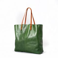 Kurva Shopper by Elk. Made from raw, natural vegetable tanned leather with saddlery leather handles. This tote is sure to meet any needs be it travel, shopping or everyday use. It has one internal zippered pouch. $272