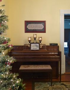 Grandmother's piano in my office.  Walls are Benjamin Moore Lemon Sorbet.  Trim is Benjamin Moore White Dove.  Christmas tree is Hobby Lobby, prelit with little frosted berries and pine cones.  It was a Christmas present from Mom and Daddy.  (Wait for the sale, and it's half price.  :o)  Mine is the 7-1/2 foot skinny one.  They have three or four sizes.  http://shop.hobbylobby.com/products/7-1/2-fast-shape-slim-snow-pine-with-lights-1030063/