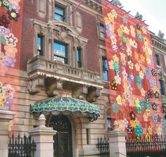 KEN SMITH'S INSTALLATION OF BRIGHTLY COLORED FLOWERS ON MESH FOR THE EXTERIOR WALLS OF THE THE COOPER-HEWITT NATIONAL DESIGN MUSEUM TYPIFY HIS WORK: HE USES SPLASHES OF COLOR THAT REVEL IN THE REALM OF THE ARTIFICIAL TO DISGUISE AND CONCEAL URBAN SURFACES.