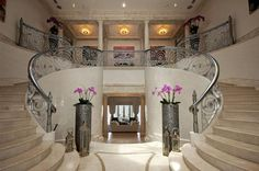 Beautiful flower design double marble staircase in bal harbour fl. Bal Harbour, Marble Staircase, Glass Elevator, Infinity Edge Pool, Mansions For Sale, Stairway To Heaven, Entry Foyer, Stairways, Decoration