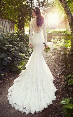 We love the long sleeve look of this sexy Wedding Dress from Essense of Australia - Style D1745