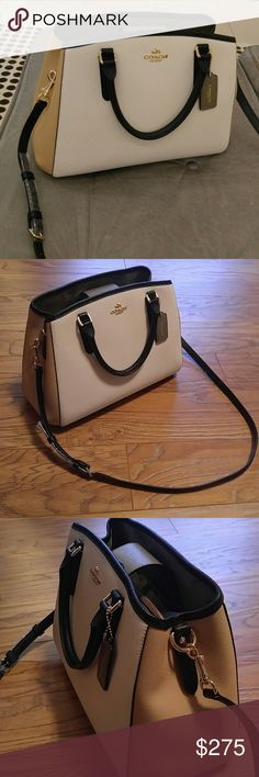 ❌SOLD❌🎉HP🎉Rare Coach Margot Color Block Fashion forward and rare in these chic colors, this authentic beauty in crossgrain leather is shades of white, tan, and black and the hangtag is grey. This stunner has grey suede or velvet  lining and gold hardware. There are 2 roomy compartments inside separated in the center with a zippered compartment for personals plus 3 wallpockets.  Magnetic closure.   Adjustable leather crossbody  shoulder strap included along with authenticity card and Coach…