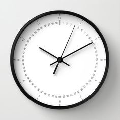 Wall clock available with natural wood frame, white or black. Possibility to choose black or white hands to match the frame clock and the art