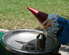 Periodically there was a fountain in the park where a thirsty gnome could take a drink.