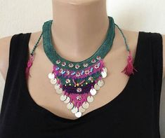 Handcrafted crochet triangle necklace. Green, pink and purple lace with pink sandbeads. Also small metal acsesories. The back of the collar is adjustable. Made from lace yarn is polyester. The total length of the collie is 70 cm. (27.55 inches) triangle width 25 cm.(9.84 inches)