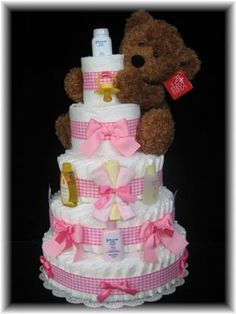 I just love this diaper cake! It's so cute and sweet and pink! I'm going to try and make one just like it for a baby shower I'm going to in a few months.