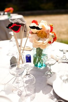 could display photo booth props like this or just have them as centre pieces next to disposable cameras