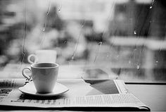 reading newspaper on a rainy day, enjoying a cuppa coffee
