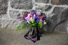 purple lavender spring bridal bouquet sophisticated floral portland oregon wedding florist ranunculus, roses, sweet peas, stock, queen annes lace, anemone, wax flower, heather, parrot tulips, maidenhair fern, feather eucalyptus, genista and succulents.