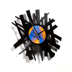 Clocks cut from old vinyl records. Really cool!