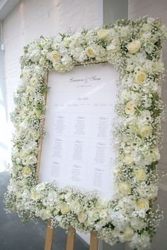 lacey white roses, hydrangeas and gypsophila table-plan floral frame from wedding at Botleys Mansion.